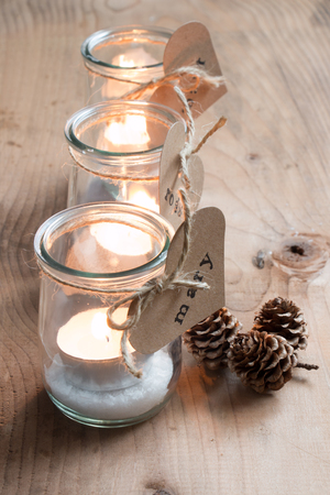 glass jars: Customized eco candle holders with jars and paper labels printed for a Christmas dinner