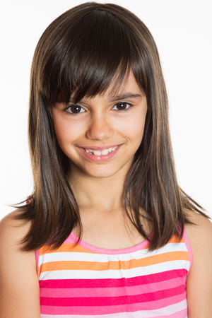 brown eyes: Beautiful little girl smiling portrait. Isolated on white