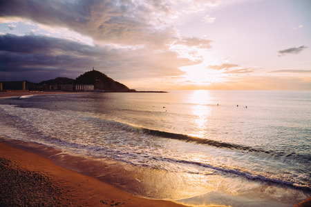seaside: Zurriola beach in the district of Gros in San Sebastian, Spain, at sunset