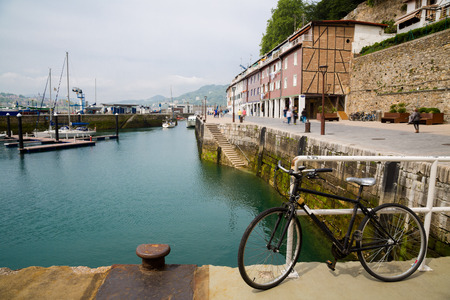 san sebastian: Old bicycle in the port of San Sebastian, Spain