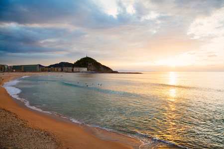 san sebastian: Zurriola beach in the district of Gros in San Sebastian, Spain, at sunset
