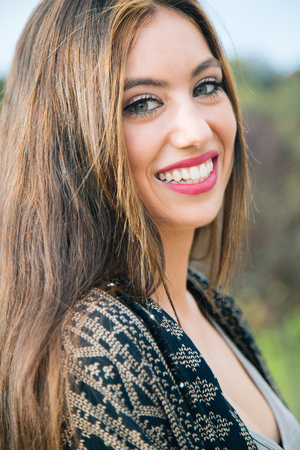 perfect teeth: Beautiful young woman smiling with a perfect teeth outdoors