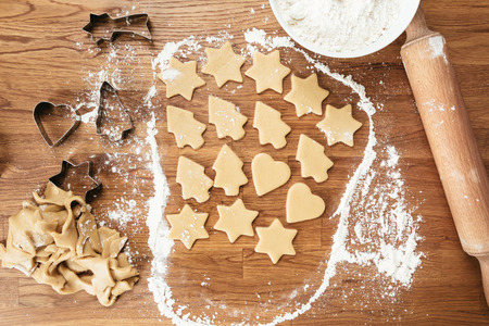wooden table top view: Cutting Christmas cookies composition. Top view of table Stock Photo