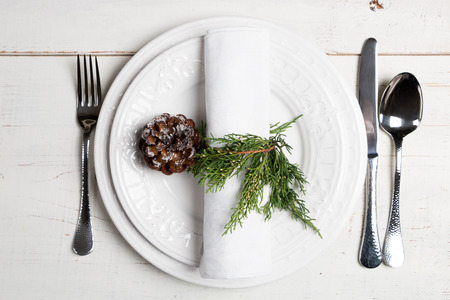 table setting: Minimal Christmas table place setting with natural ornaments