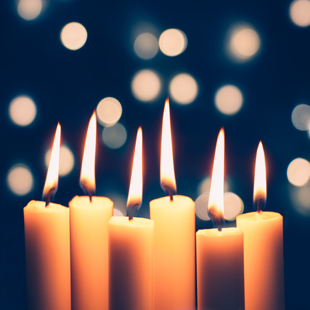 christmas candles burning and bokeh of christmas lights at the background stock photo 69322116