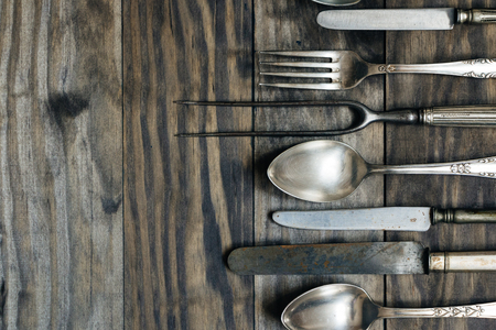 Old cutlery on a rustic wooden table