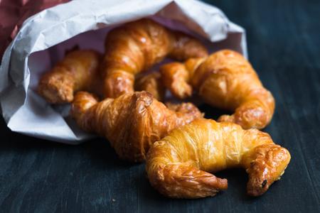 Mini croissants in a paper bag