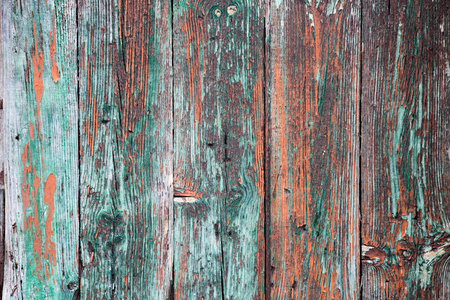 Old wood background with peeling layers of paint