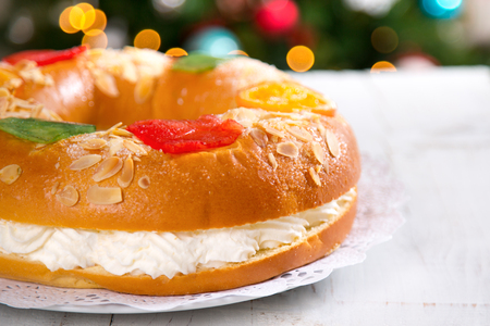 Roscon de reyes , Spanish typical dessert of Epiphany, with cream filling Imagens