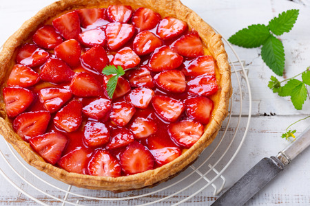 Homemade strawberry tart decorated with strawberry leaves