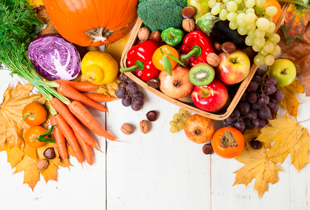Assortment of fresh and ripe autumn vegetables and fruits on a rustic wooden table. Top view Stock Photo