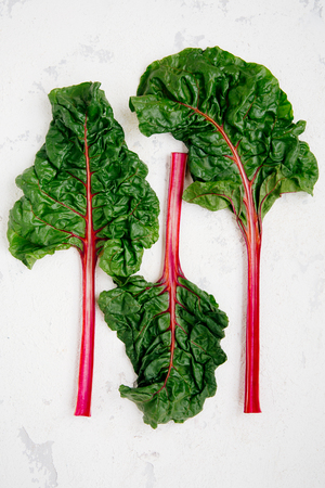 Swiss chard leaves on a rugged white background Stock Photo