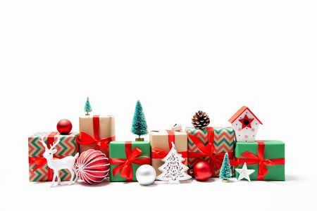 Christmas gifts and ornaments in a row in the shape of a cityscape. Isolated on white Stockfoto