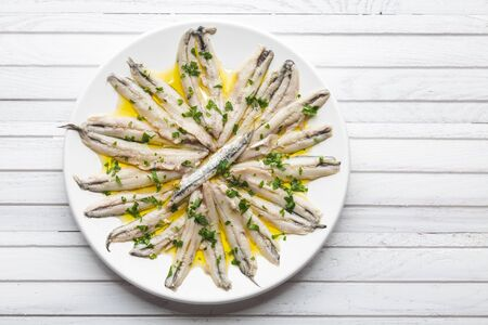 Marinated anchovies in vinegar with olive oil and parsley. Traditional spanish tapa