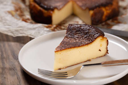 Portion of the traditional basque burnt cheesecake close up Standard-Bild