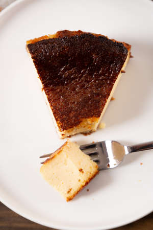 Portion of the traditional basque burnt cheesecake on a plate ready to eat