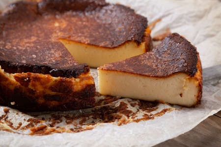 Traditional basque burnt cheesecake on the baking paper