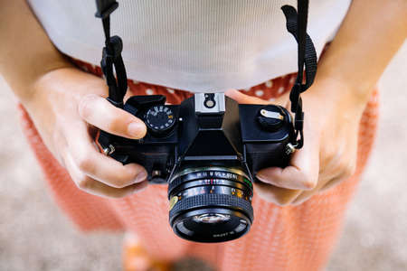 Retro SLR camera in a young woman hands Standard-Bild