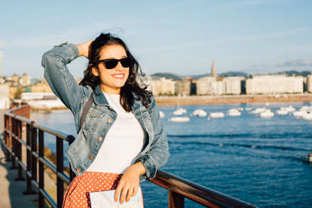 Happy young tourist woman ejoying the view of