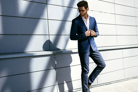 dressed: Walking business man. Elegant young handsome man wearing glasses and watchers.