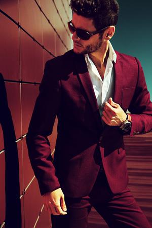 legant young handsome man. Outdoors fashion portrait. Man with glasses. Standard-Bild