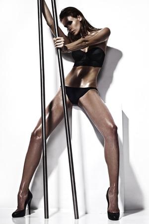 Mooie verleidelijke jonge vrouw in sexy lingerie Stockfoto