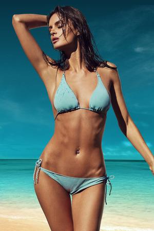 beach girl: Beautiful girl posing on the beach in the hot sun, outdoor portrait