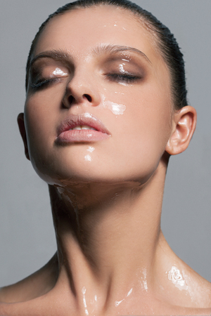 Girl with a silicone mask on her face