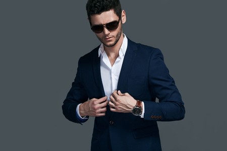 Elegant young handsome man wearing glasses and wathers. Stockfoto