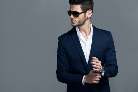 male fashion model: Elegant young handsome man wearing glasses and wathers. Stock Photo
