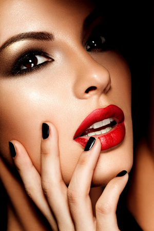 lip: Beautiful young model with red lips. Bright makeup.