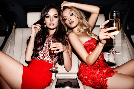 luxuries: Sexy girls in the car. Celebrating.