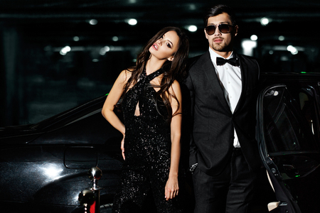 club dress: Sexy couple in the car. Hollywood stars. Stock Photo