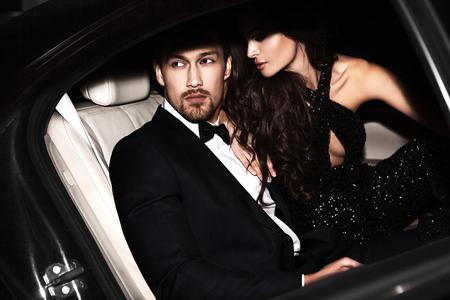 hollywood movie: Sexy couple in the car. Hollywood stars. Stock Photo