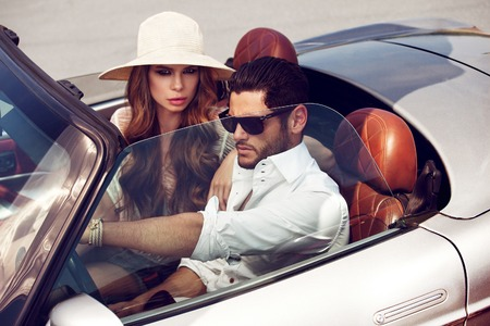 luxuries: Sexy couple in the car. Luxury life.