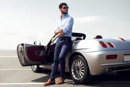 Handsome man near the car. Luxury life.