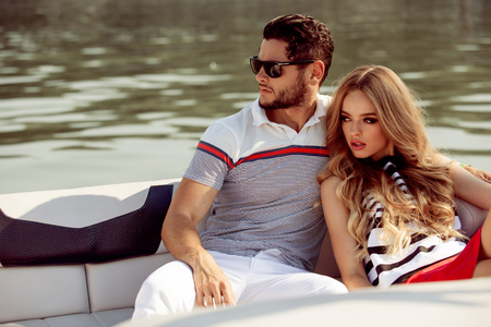 summer dress: Sexy couple on the luxury boat