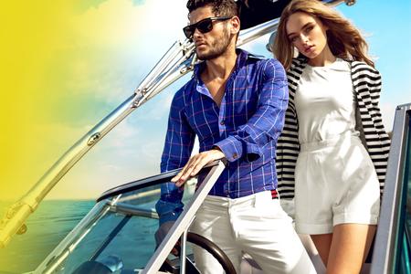 Sexy couple on the luxury yacht photo