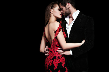 Fashion photo of elegant couple in the tender passion Foto de archivo