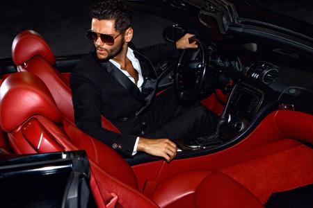Men in luxury car. Night life. 版權商用圖片