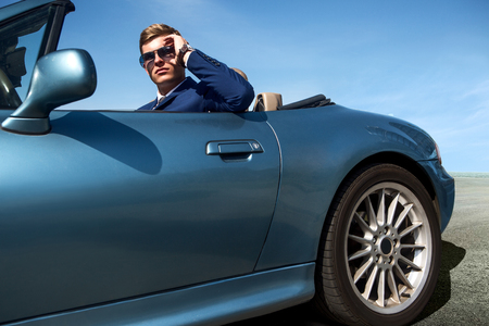 Handsome man in the car, businessman Stok Fotoğraf