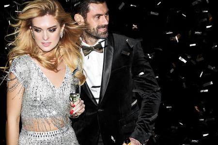Sexy elegant couple. Beautiful woman near the man. 스톡 콘텐츠