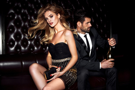 Sexy elegant couple. Beautiful woman near the man. Stock fotó