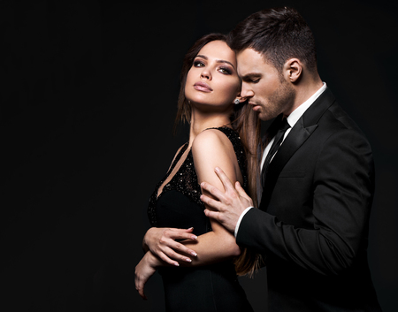 Best elegant couple in the tender passion. Black background.