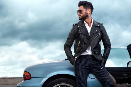 Handsome man near the car.