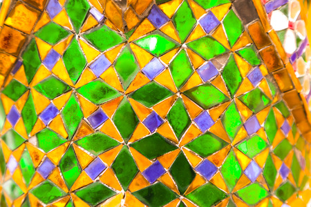 Beautiful closeup textures abstract tiles painting and gold and colorful glass wall background and art