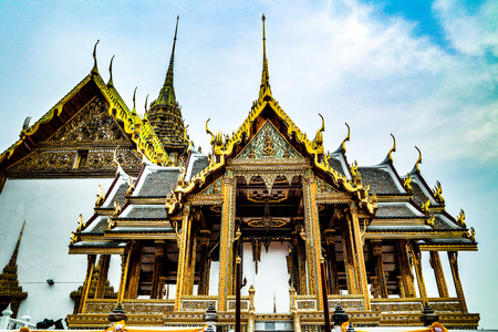 Wat Phra Kaew or Temple of Emerald Buddha, Guardian statues and Grand palace located within the grounds of the Grand Palace in Bangkok is Thailand's most sacred temple and pilgrimage site for Thai