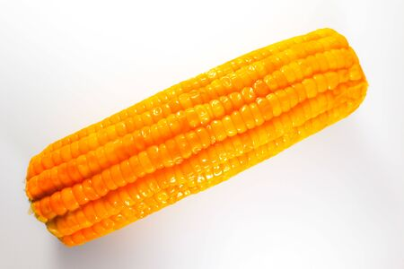 Corn isolated on the white background and wallpaper
