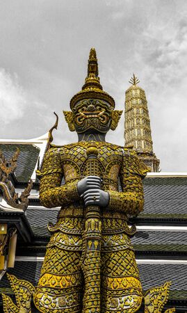 Beautiful close up color black white and gold Wat Phra Kaew or Temple of Emerald Buddha, Guardian statues pagoda and Grand palace located within the grounds of the Grand Palace in Bangkok 免版税图像 - 127645186