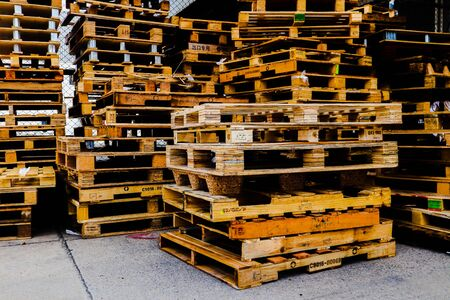 Wooden pallets stack at the freight cargo warehouse for transportation and logistics industrial